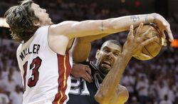 San Antonio Spurs power forward Tim Duncan (21) works as Miami Heat shooting guard Mike Miller (13) defends during the second half of Game 6 of the NBA Finals basketball game, Tuesday, June 18, 2013, in Miami. (AP Photo/Lynne Sladky)