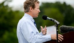 """** FILE ** Sen. Rand Paul, Kentucky Republican, speaks at a tea party rally against the Internal Revenue Service titled """"Audit the IRS"""" on the West Lawn of the U.S. Capitol in Washington on Wednesday, June 19, 2013. (Andrew Harnik/The Washington Times)"""