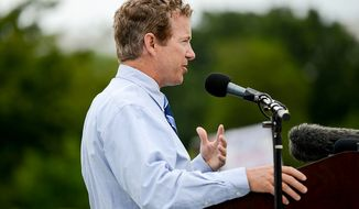 "** FILE ** Sen. Rand Paul, Kentucky Republican, speaks at a tea party rally against the Internal Revenue Service titled ""Audit the IRS"" on the West Lawn of the U.S. Capitol in Washington on Wednesday, June 19, 2013. (Andrew Harnik/The Washington Times)"