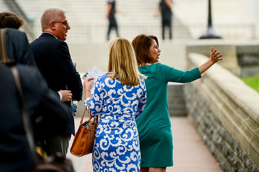 "Conservative talk show host Glenn Beck, left, and Rep. Michele Bachmann (R-Minn.), right, wave to supporters after speaking at a tea party rally against the Internal Revenue Service titled, ""Audit the IRS"" on the West Lawn of the U.S. Capitol Building, Washington, D.C., Wednesday, June 19, 2013. (Andrew Harnik/The Washington Times)"