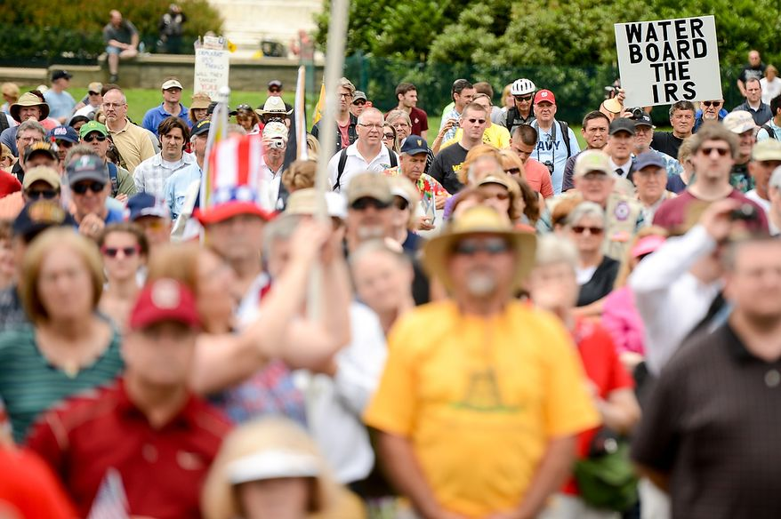 """Tea party supporters listen to speakers at a rally against the Internal Revenue Service entitled, """"Audit the IRS"""" on the West Lawn of the U.S. Capitol Building, Washington, D.C., Wednesday, June 19, 2013. (Andrew Harnik/The Washington Times)"""