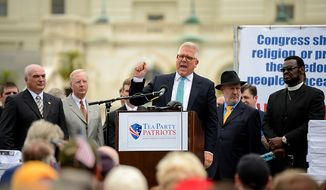 """Conservative talk show host Glenn Beck speaks at a tea party rally against the Internal Revenue Service entitled, """"Audit the IRS"""" on the West Lawn of the U.S. Capitol Building, Washington, D.C., Wednesday, June 19, 2013. (Andrew Harnik/The Washington Times)"""