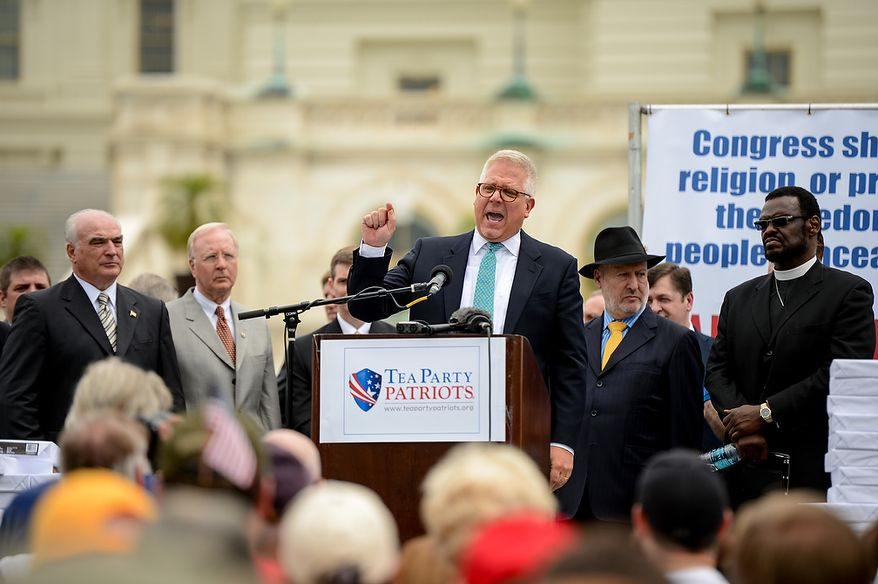 "Conservative talk show host Glenn Beck speaks at a tea party rally against the Internal Revenue Service entitled, ""Audit the IRS"" on the West Lawn of the U.S. Capitol Building, Washington, D.C., Wednesday, June 19, 2013. (Andrew Harnik/The Washington Times)"