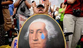 ** FILE ** David Grimm, of Pittsburg, Pa. holds a poster depicting George Washington with a teardrop, during a tea party rally on the West Lawn of the U.S. Capitol Building, Washington, D.C., Wednesday, June 19, 2013. (Andrew Harnik/The Washington Times)