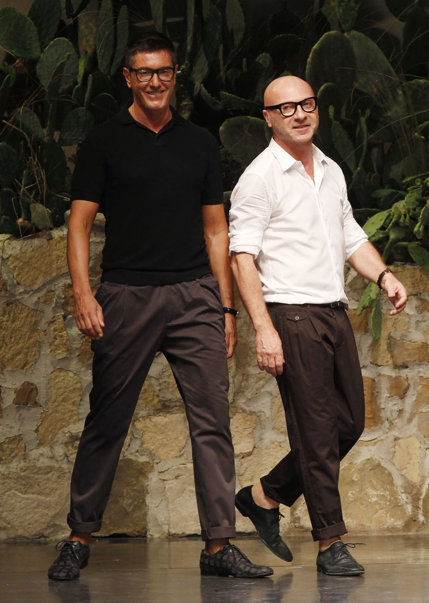 Italian fashion designers Stefano Gabbana (left) and Domenico Dolce take the catwalk after presenting their Dolce&Gabbana fashion collection in Milan on June 23, 2012. (AP Photo/Luca Bruno)