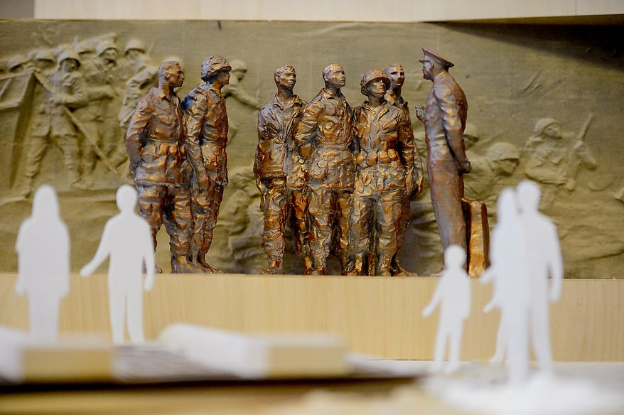 A model of the proposed Eisenhower Memorial is displayed at a public meeting of the Eisenhower Memorial Commission on Capitol Hill, Washington, D.C., Wednesday, June 19, 2013. The Commission met to discuss the continuing controversy over Frank Gehry's design for a memorial honoring Dwight D. Eisenhower. (Andrew Harnik/The Washington Times)