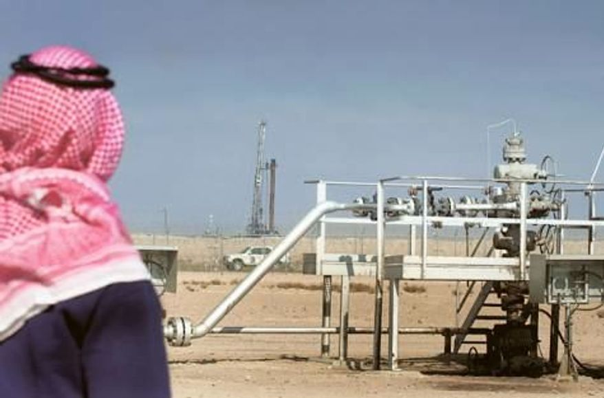 ** FILE ** The Ratqa oilfield in the northern Kuwaiti desert. (Associated Press)