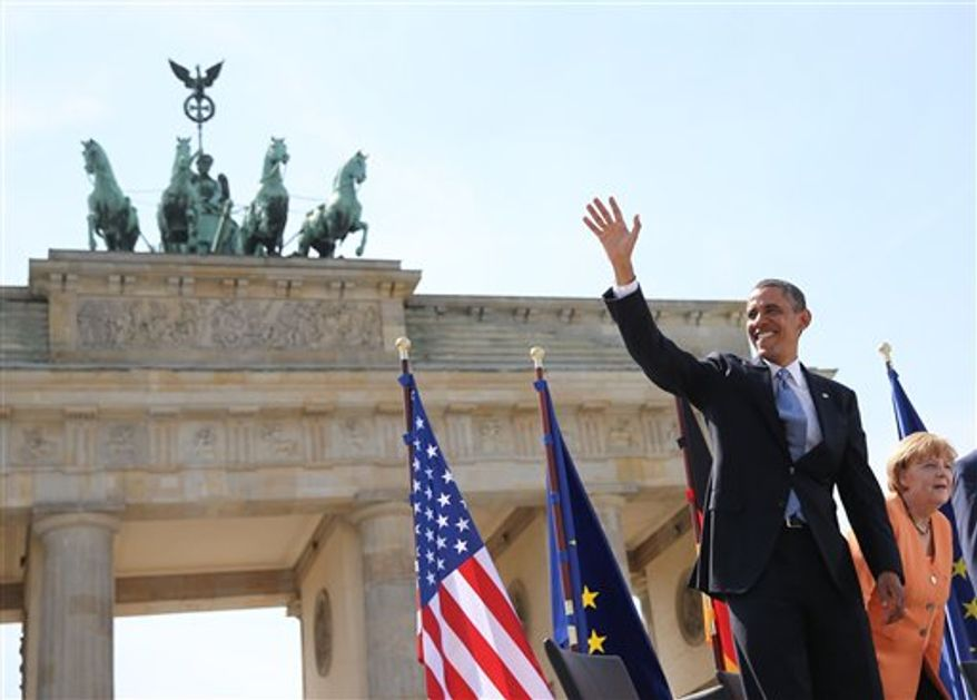 U.S. President Barack Obama, left, stands next to German Chancellor Angela Merkel, right, in front of Brandenburg Gate at Pariser Platz in Berlin, Germany, Wednesday June 19, 2013. On the second day of his visit to Germany, Obama met with German President Joachim Gauck and Ms. Merkel before delivering a speech at Brandenburg Gate. (AP Photo/dpa,Michael Kappeler, Pool)