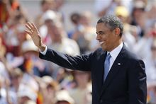 U.S. President Barack Obama waves as he arrives for a speech at Brandenburg Gate where he is to deliver a speech in Berlin Wednesday, June 19, 2013. Obama is on a two-day official visit to the German capital. (AP Photo/Markus Schreiber)