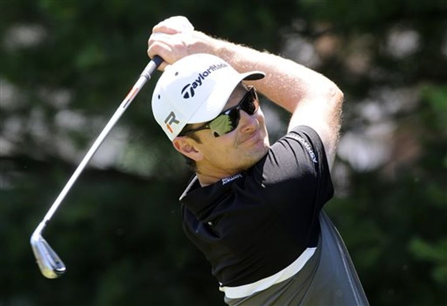 Justin Rose, of England, winner of the 2013 U.S. Open, hits a tee shot during the Travelers Championship golf tournament pro-am in Cromwell, Conn., Wednesday, June 19, 2013. (AP Photo/Fred Beckham)
