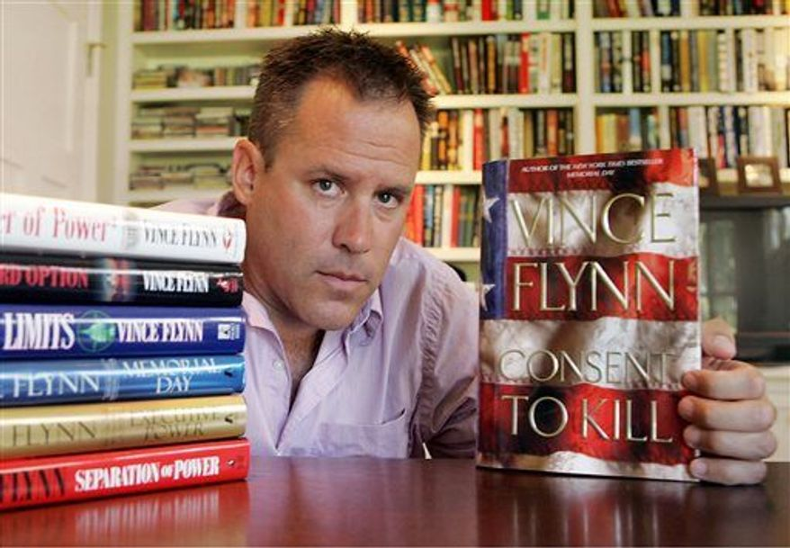 "Best-selling author Vince Flynn died, Wednesday, June 18, 2013, after a two-year battle with prostate cancer, a statement from Flynn's publisher, Simon & Schuster, Inc., said. He was 47. The author is shown here promoting ""Consent to Kill"" in 2005. (Associated Press)"