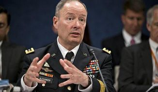 **FILE** Gen. Keith B. Alexander, director of the National Security Agency and head of the U.S. Cyber Command, testifies before the House Permanent Select Committee on Intelligence on Capitol Hill in Washington on June 18, 2013. (Associated Press)