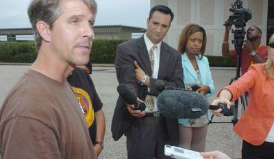 **FILE** Chris Simcox, the president of the Minuteman Civil Defense Corps, addresses the media at West Houston Airport on Aug. 14, 2005, regarding the issue of border patrols and their training and tactics. (Associated Press)