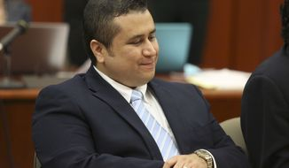 ** FILE ** George Zimmerman smiles as attorney Mark O'Mara questions potential jurors for Zimmerman's trial in Seminole circuit court in Sanford, Fla., on June 20, 2013. (Associated Press/Orlando Sentinel)