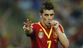 Spain's David Villa celebrates scoring his side's 7th goal during the soccer Confederations Cup group B match between Spain and Tahiti at Maracana stadium in Rio de Janeiro, Brazil, Thursday, June 20, 2013. (AP Photo/Victor R. Caivano)
