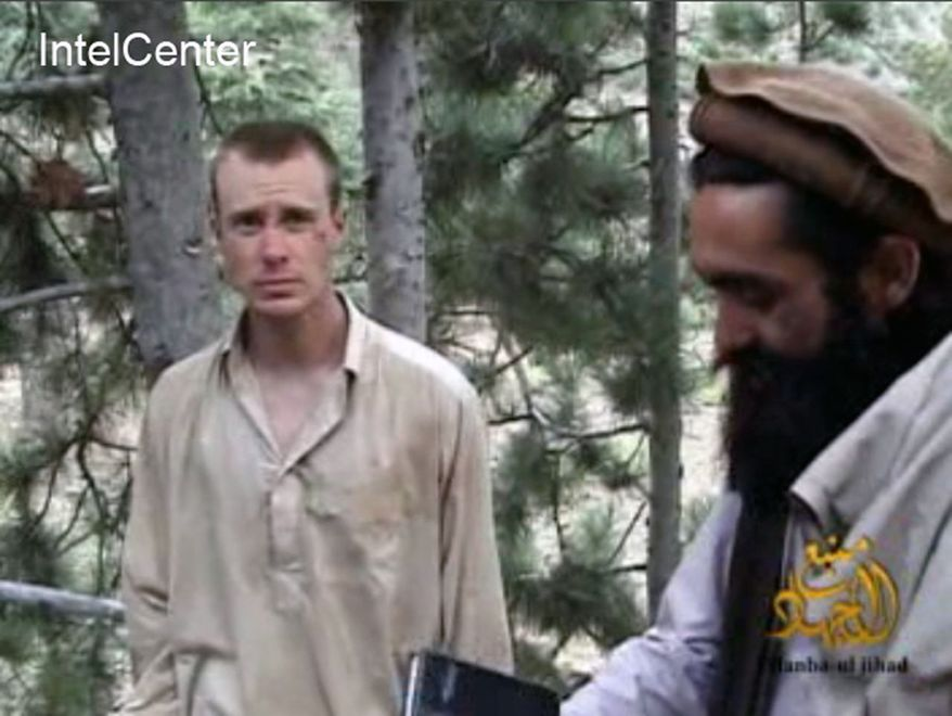 ** FILE ** This file image provided by IntelCenter on Wednesday Dec. 8, 2010, shows a frame grab from a video released by the Taliban containing footage of a man believed to be a U.S. soldier, Sgt. Bowe Bergdahl, left. (AP Photo/IntelCenter, File)