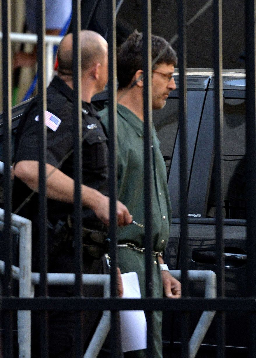 Glendon Scott Crawford, 49, of Galway, N.Y., leaves the federal courthouse in shackles after being arraigned Wednesday, June 19, 2013, in Albany, N.Y. Federal authorities accused Crawford and 54-year-old Eric J. Feight, of Hudson, N.Y. of assembling a portable X-ray weapon that they intended to use to secretly sicken opponents of Israel. (AP Photo/The Albany Times Union, Skip Dickstein)