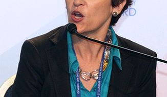 **FILE** Caroline Atkinson, director of external relations for the International Monetary Fund, holds a press conference at Daejeon Convention Center in Korea on July 12, 2010. (Associated Press)