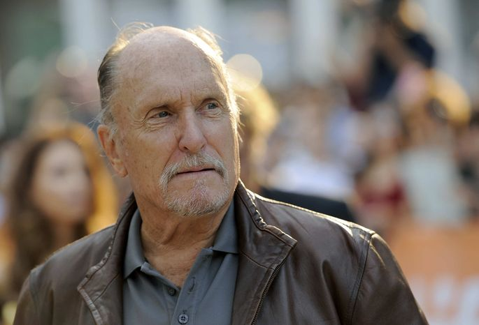 """** FILE ** Robert Duvall, a cast member in the film """"Jayne Mansfield's Car,"""" arrives at the premiere of the film at the 2012 Toronto Film Festival, Thursday, Sept. 13, 2012, in Toronto. Duvall is one of the spectators at the racketeering trial of reputed gangster James """"Whitey"""" Bulger. Duvall sat in the back of the courtroom Friday, June 21, 2013, at the trial in Boston. (Photo by Chris Pizzello/Invision/AP, File)"""
