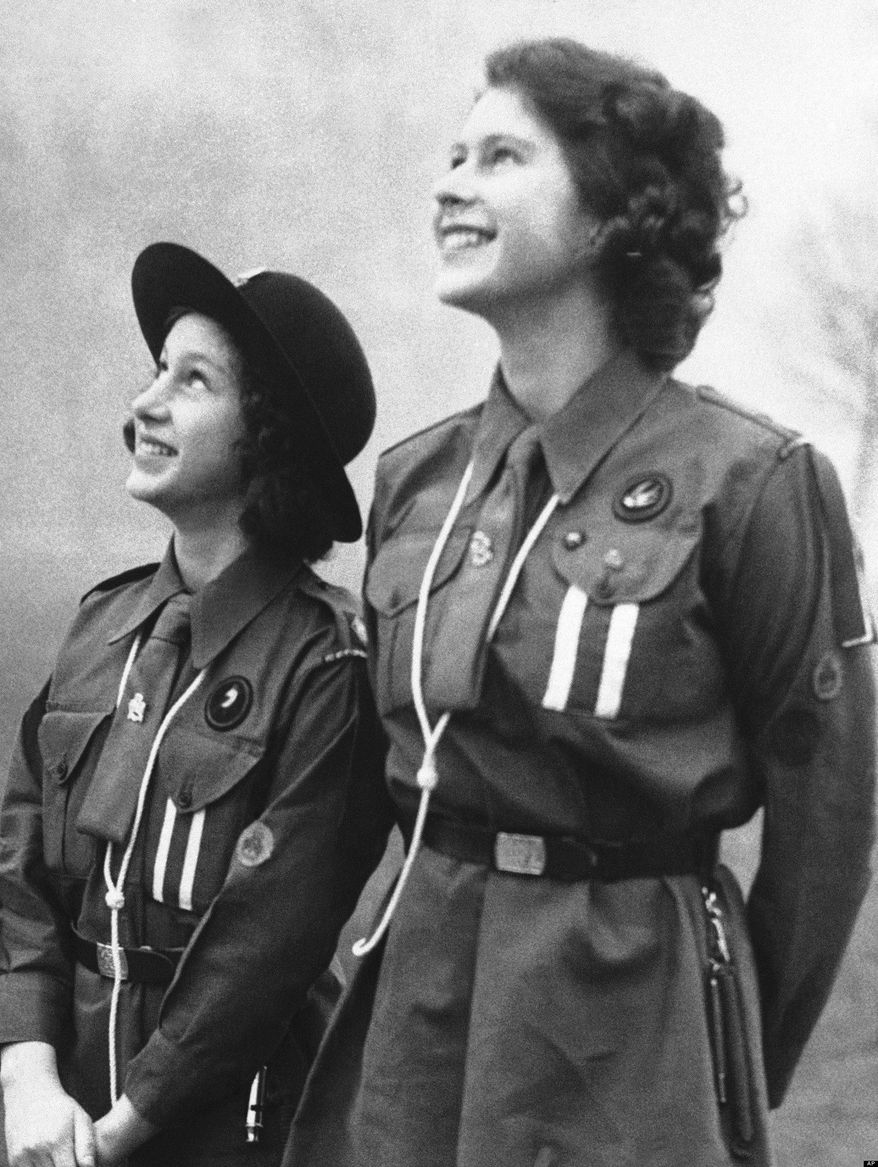 ** FILE ** Britain's Princess Elizabeth releasing a carrier pigeon in honor of the late Lord Baden-Powell, founder of Britain's Scout movement, Feb. 20, 1943. (Associated Press)