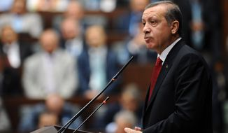 ** FILE ** Turkey's Prime Minister Recep Tayyip Erdogan addresses his lawmakers at parliament, in Ankara, Turkey, Tuesday, June 18, 2013. (AP Photo)