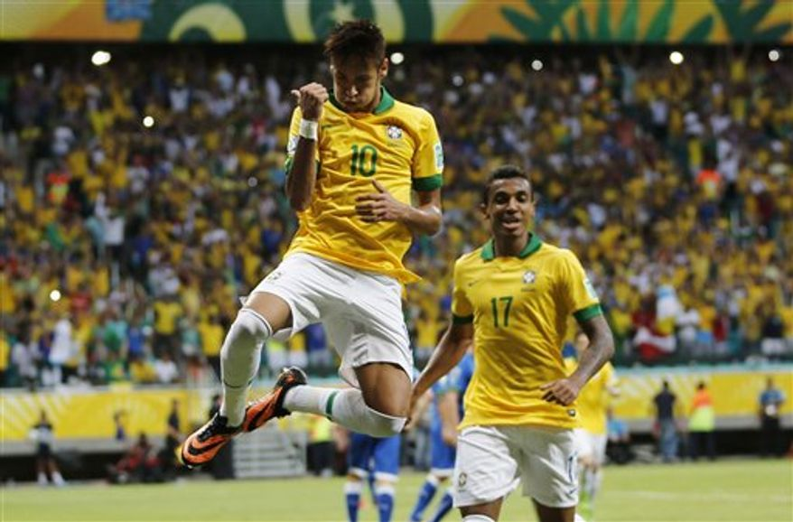 Brazil's Neymar celebrates scoring his side's 2nd goal during the soccer Confederations Cup group A match between Italy and Brazil at Fonte Nova stadium in Salvador, Brazil, Saturday, June 22, 2013. (AP Photo/Fernando Llano)