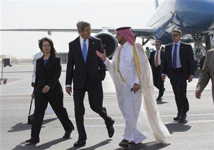 U.S. Ambassador to Qatar Susan Ziadeh, left, walks with U.S. Secretary of State John Kerry, second from left, and Ambassador Ibrahim Fakhroo, Qatari Chief of Protocol, on Kerry's arrival in Doha, Qatar, on Saturday, June 22, 2013. (Associated Press)