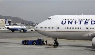 ** FILE ** United Airlines planes taxing at San Francisco International Airport in San Francisco, Feb. 23, 2013. (AP Photo/Eric Risberg, File)