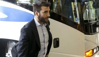 Boston Bruins center Patrice Bergeron arrives at the team's hotel Friday, June 21, 2013 in Chicago. The Bruins face the Chicago Blackhawks in Game 5 of the Stanley Cup Final on Saturday. (AP Photo/Charles Rex Arbogast)