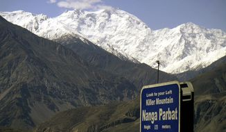 Nanga Parbat, the ninth-highest mountain in the world, is seen from the Karakorum Highway, leading to neighboring China, in Pakistan's northern area. Gunmen wearing police uniforms killed nine foreign tourists and one Pakistani before dawn on Sunday, June 23, 2013, at the base camp on the mountain. (AP Photo/Musaf Zaman Kazmi)