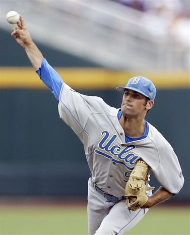 UCLA starting pitcher Adam Plutko works against LSU in the first inning of an NCAA College World Series baseball game in Omaha, Neb., Sunday, June 16, 2013. (AP Photo/Nati Harnik)