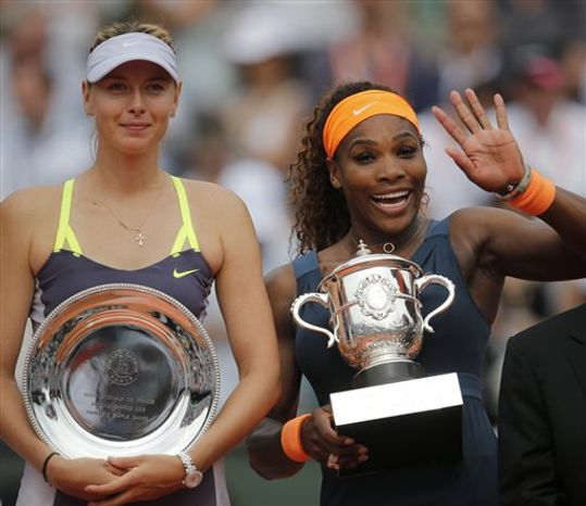 **FILE** Serena Williams of the U.S., right, holds the trophy after defeating Russia's Maria Sharapova, left, in two sets 6-4, 6-4, in the women's final of the French Open tennis tournament, at Roland Garros stadium in Paris, Saturday June 8, 2013. (AP Photo/Christophe Ena)