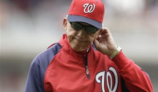 Washington Nationals manager Davey Johnson walks back to the dougout after pulling starting pitcher Ross Detwiler in the fourth inning of a baseball game against the Colorado Rockies at Nationals Park, Sunday, June 23, 2013, in Washington. (AP Photo/Carolyn Kaster)
