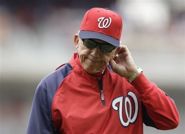 Washington Nationals manager Davey Johnson walks back to the dougout after pulling starting pitcher Ross Detwiler in the fourth inning of a baseball game against