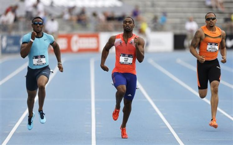 Tyson Gay, center, leads Isiah Young, left, and Wallace Spearmon, right, during the senior men's 200-meter dash finals at the U.S. Championships athletics meet on Sunday, June 23, 2013, in Des Moines, Iowa. Gay won the race. (AP Photo/Charlie Neibergall)