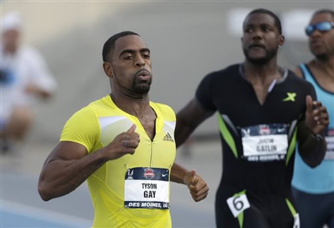 Tyson Gay, left, beats Justin Gatlin to the finish line in their heat in the senior men's 100-meter dash at the U.S. Championships athletics meet on Friday, June 21, 2013, in Des Moines, Iowa. (AP Photo/Charlie Neibergall)