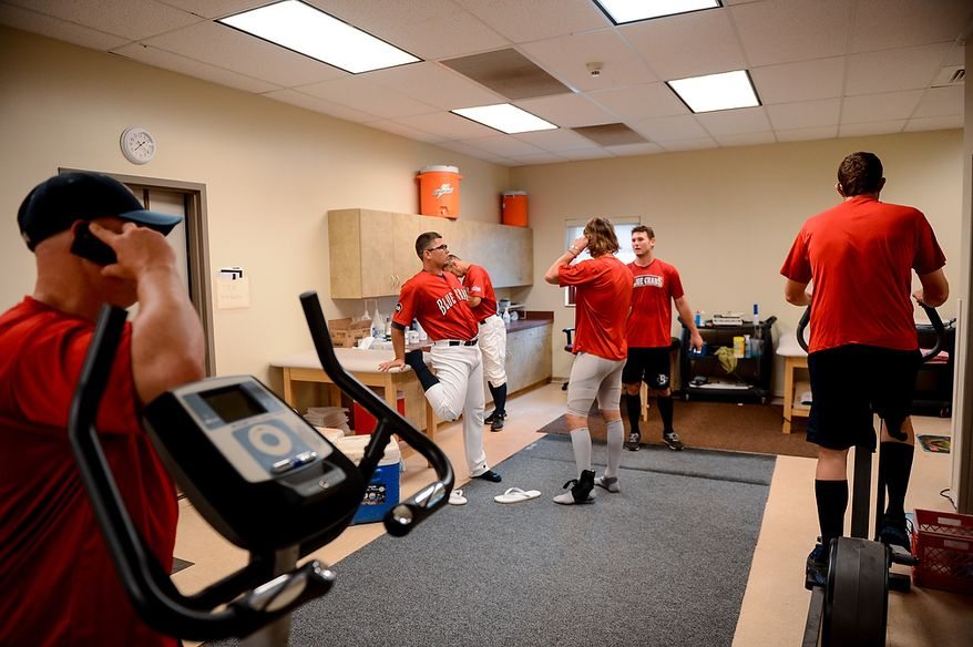Players for the Blue Crabs get ready in the locker room  before the independent baseball league's Blue Crabs play the Camden RiverSharks at Regency Furniture Stadium, Waldorf, Md., Sunday, June 23, 2013. (Andrew Harnik/The Washington Times)