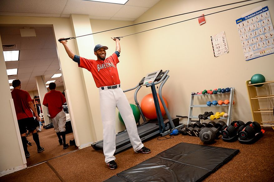 Blue Crabs pitcher Daryl Thompson (3) works out in the locker room before the independent baseball league's Blue Crabs play the Camden RiverSharks at Regency Furniture Stadium, Waldorf, Md., Sunday, June 23, 2013. (Andrew Harnik/The Washington Times)