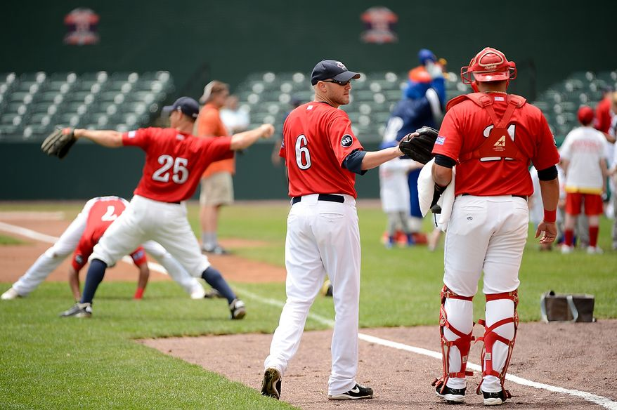 Blue Crabs pitcher Charlie Manning (6), center, warms up with his team before the independent baseball league's Blue Crabs play the Camden RiverSharks at Regency Furniture Stadium, Waldorf, Md., Sunday, June 23, 2013. (Andrew Harnik/The Washington Times)
