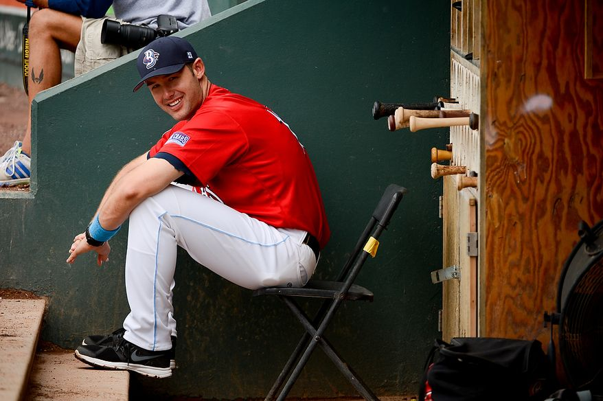 Blue Crabs manager Patrick Osborn (13) sits in the dugout as the independent baseball league's Blue Crabs play the Camden RiverSharks at Regency Furniture Stadium, Waldorf, Md., Sunday, June 23, 2013. (Andrew Harnik/The Washington Times)