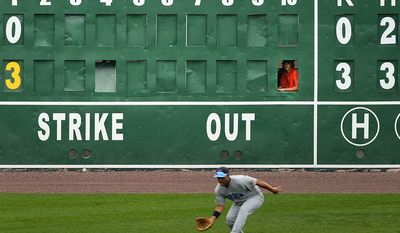Andrew Malharek watches game action while running the stadium's scoreboard as the independent baseball league's Blue Crabs play the Camden RiverSharks at Regency Furniture Stadium, Waldorf, Md., Sunday, June 23, 2013. (Andrew Harnik/The Washington Times)