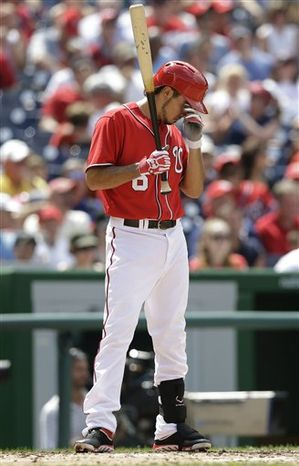 Washington Nationals third baseman Anthony Rendon pauses during an at bat during the fifth inning of a baseball game against the Colorado Rockies at Nationals Park, Sunday, June 23, 2013, in Washington. (AP Photo/Carolyn Kaster)