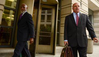 Stanley A. Straughter, left, leaves the United States District Court for the District of Columbia with his attorney Steven McCool, right, after pleading guilty to making straw donations as an investigation into a D.C. campaign finance  scheme continues, Washington, D.C., Monday, June 24, 2013. (Andrew Harnik/The Washington Times)