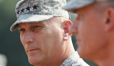 Gen. Raymond T. Odierno, Chief of Staff of the Army,right, and Gen. David M. Rodriguez wait to be introduced during Forces Command Assumption of command ceremony at Fort Bragg, N.C., Monday, Sept. 12, 2011. (AP Photo/Jim R. Bounds)