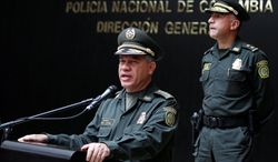 """Colombia's National Police Chief Gen. Jose Roberto Leon Riano announces the arrest of four gang members Tuesday in the death last week of DEA Special Agent James """"Terry"""" Watson."""
