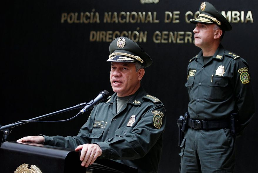 "Colombia's National Police Chief Gen. Jose Roberto Leon Riano announces the arrest of four gang members Tuesday in the death last week of DEA Special Agent James ""Terry"" Watson."