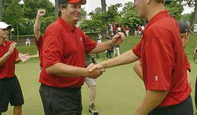 **FILE** Georgia coach Chris Haack congratulates Brendon Todd after Georgia won the NCAA Division 1 Men's golf team championship final round Saturday, June 4, 2005, in Owings Mills, Md. (AP Photo/Gail Burton).