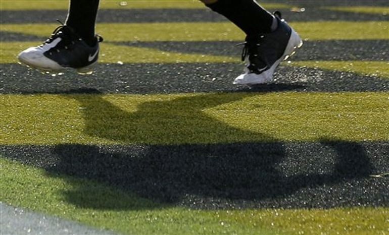 The shadow of a Southern Miss player is seen in the first half of an NCAA football game against Navy in Annapolis, Md., Saturday, Oct. 7, 2011. (AP Photo/Patrick Semansky)