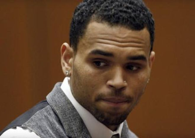 Chris Brown sitting in a Los Angeles courtroom, Sept. 25, 2012. (Assoc