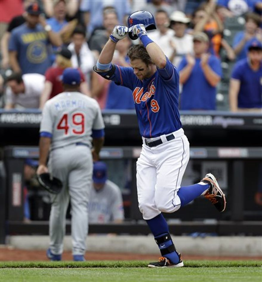 **FILE** New York Mets Kirk Nieuwenhuis (9) removes his cap as he runs past Chicago Cubs relief pitcher Carlos Marmol (49) after hitting a ninth-inning, three-run, home run off Marmol in a baseball game in New York, Sunday, June 16, 2013. (AP Photo/Kathy Willens)
